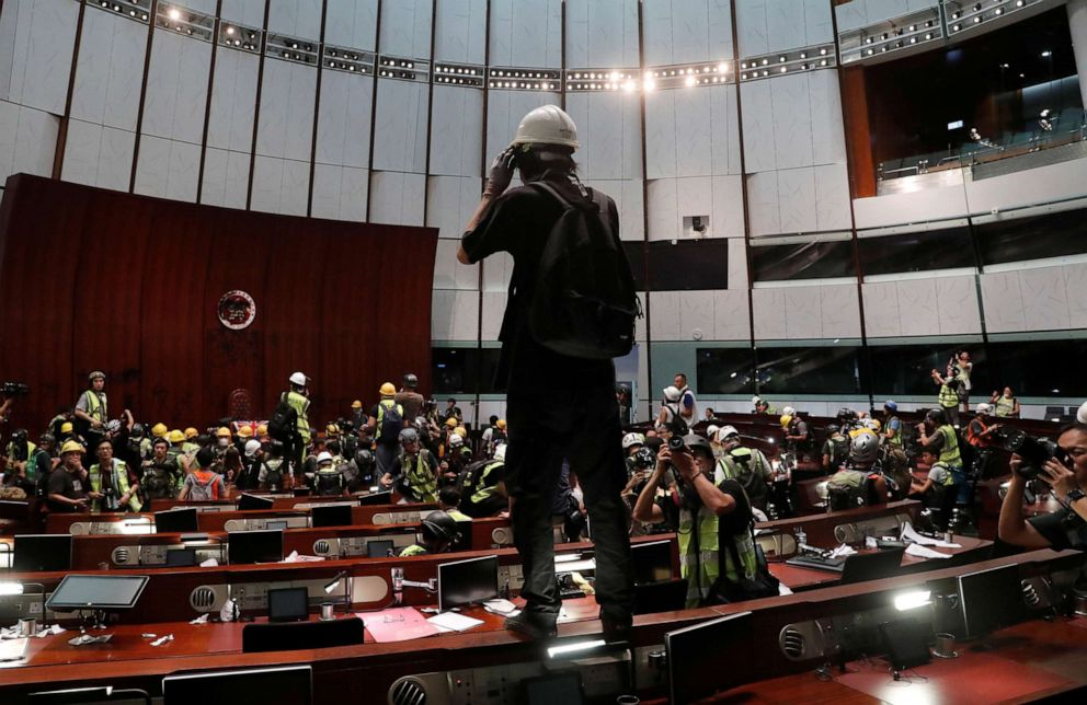 PHOTO: Protesters are seen inside a chamber after they broke into the Legislative Council building during the anniversary of Hong Kongs handover to China in Hong Kong, July 1, 2019.