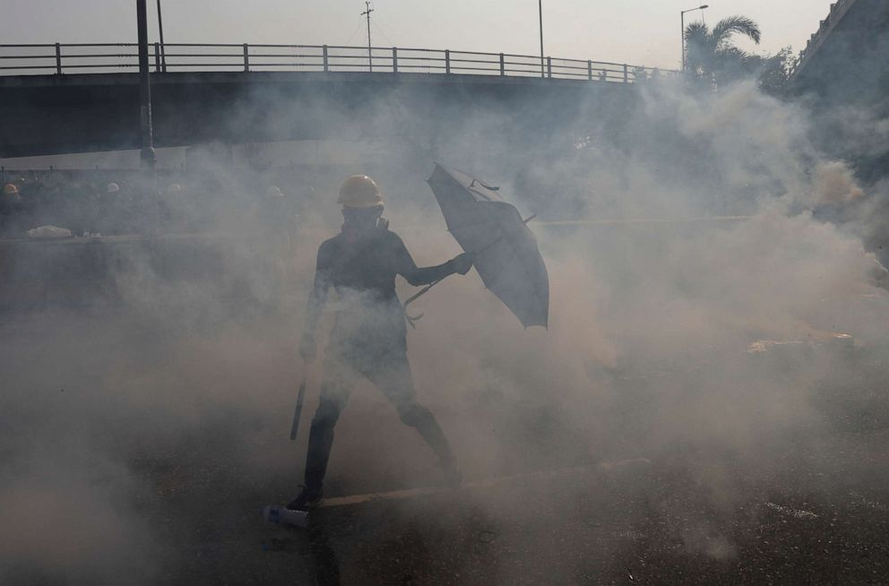 PHOTO: Tear gas floats in the air as demonstrators clash with riot police during a protest at Kowloon Bay in Hong Kong, China, August 24, 2019.