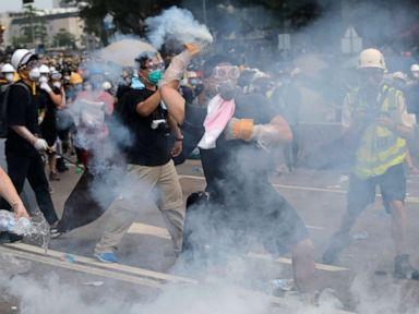 Hong Kong protesters tear-gassed by police as tensions spiral over extradition bill