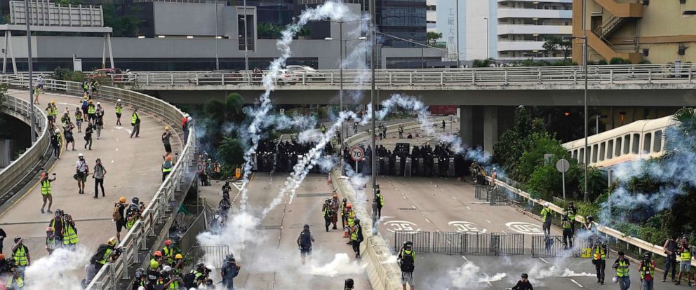 PHOTO: Clouds of smoke rise from tear gas canisters as police and demonstrators clash during a protest in Hong Kong, Saturday, Aug. 24, 2019.