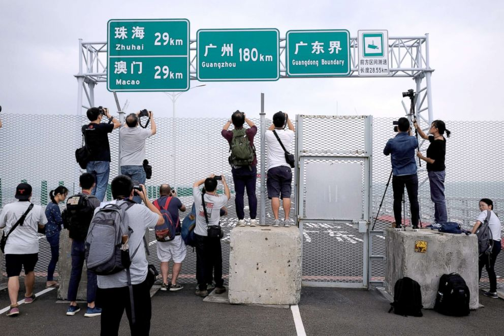 PHOTO: Members of the media take pictures on the Hong Kong side of the Hong Kong-Zhuhai-Macau bridge, Oct. 19, 2018, days before its opening ceremony.