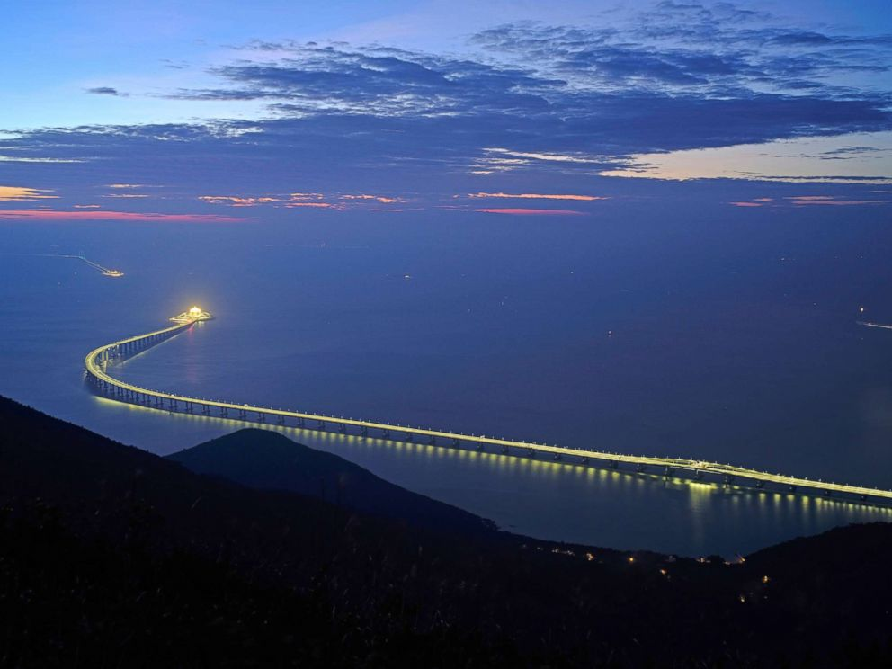 PHOTO: The Hong Kong-Zhuhai-Macau Bridge is lit up in Hong Kong, Oct. 21, 2018. The bridge, the worlds longest cross-sea project, which has a total length of 34 miles, will have opening ceremony in Zhuhai on Oct. 23.