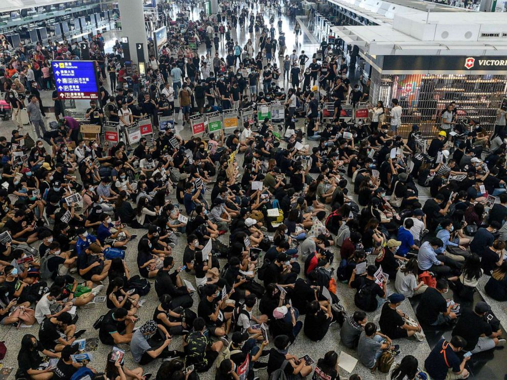 China's Hong Kong office condemns airport clashes as 'near-terrorist acts'