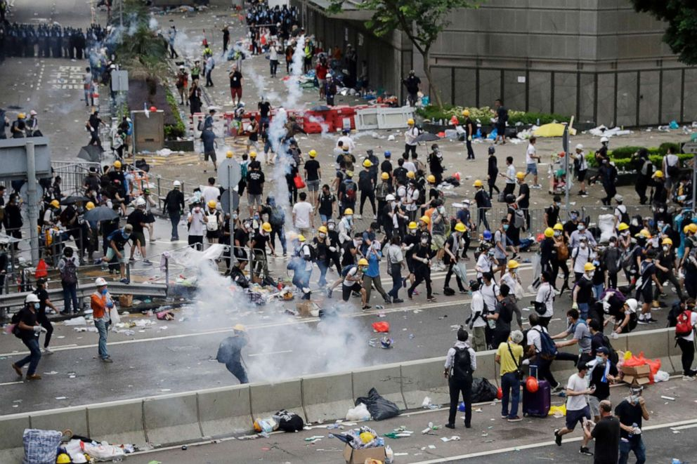 PHOTO: Riot police fire tear gas to protesters outside the Legislative Council in Hong Kong, June 12, 2019.