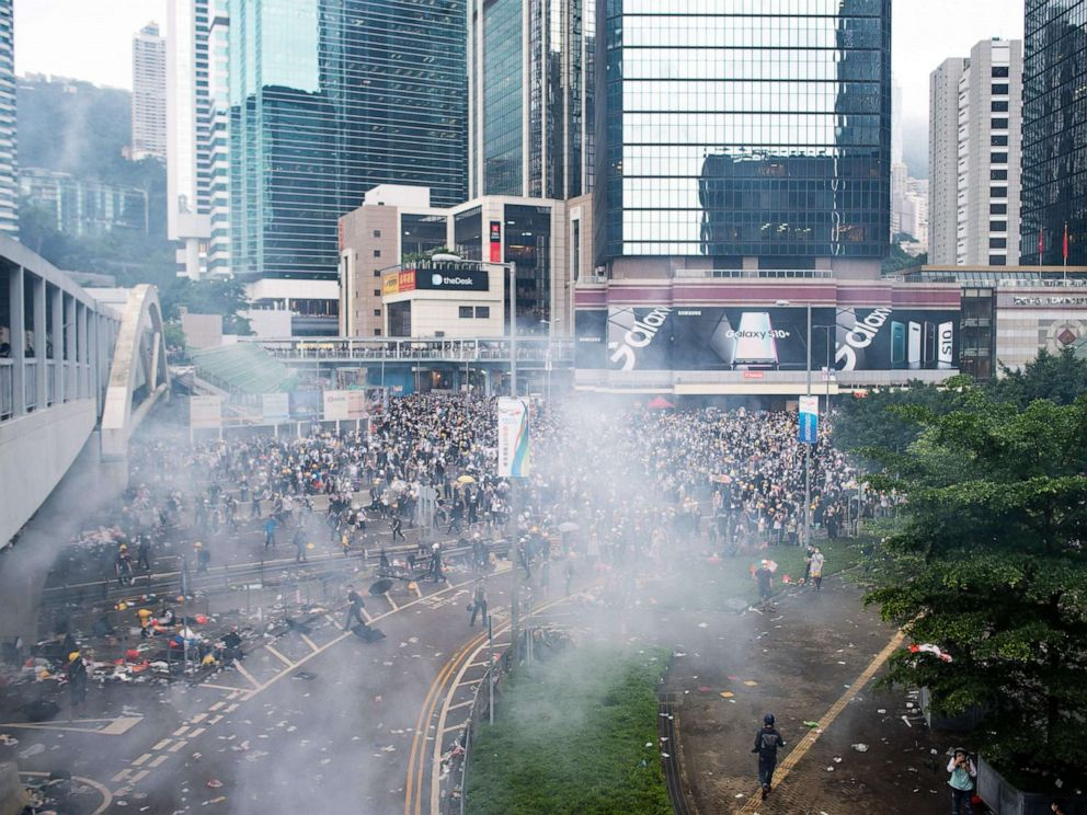 PHOTO: Tear gas is seen outside the Legislative Council during violent clashes between police and protesters rallying against a controversial extradition law proposal outside the government headquarters in Hong Kong, June 12, 2019.