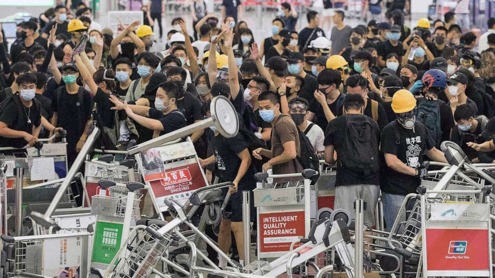 Riot police storm Hong Kong airport as protesters force second day of cancellations thumbnail