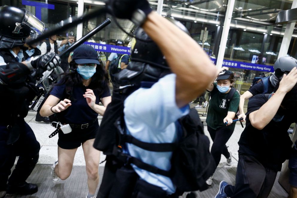 Hong Kong airport protesters retreat, but city in turmoil