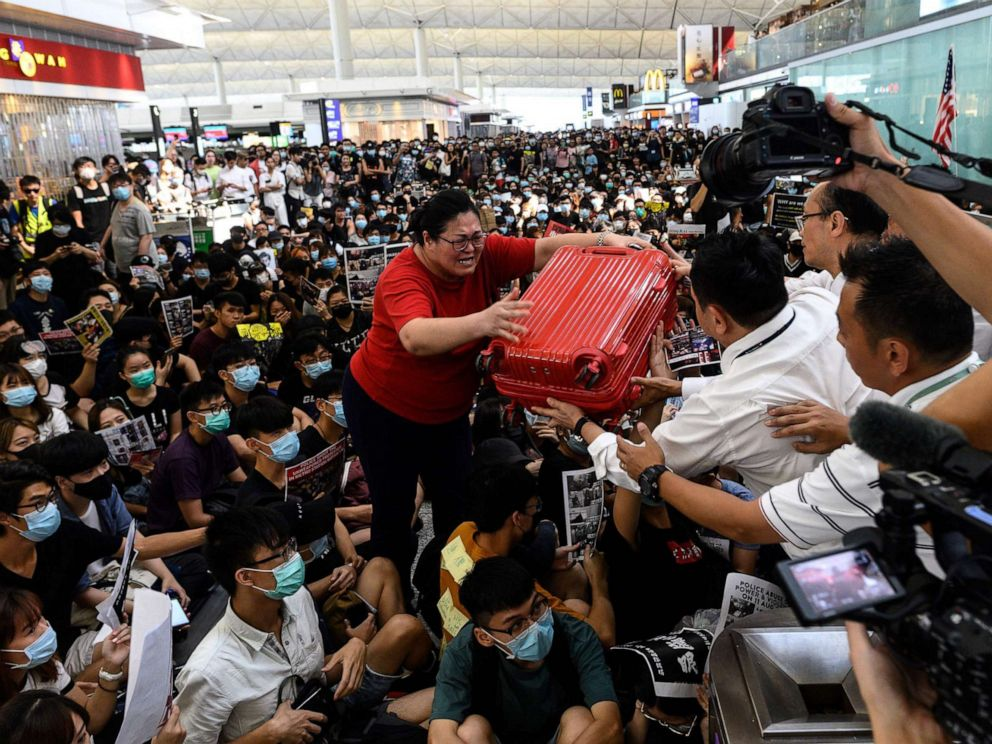 China says protesters like 'terrorists'; airport reopens