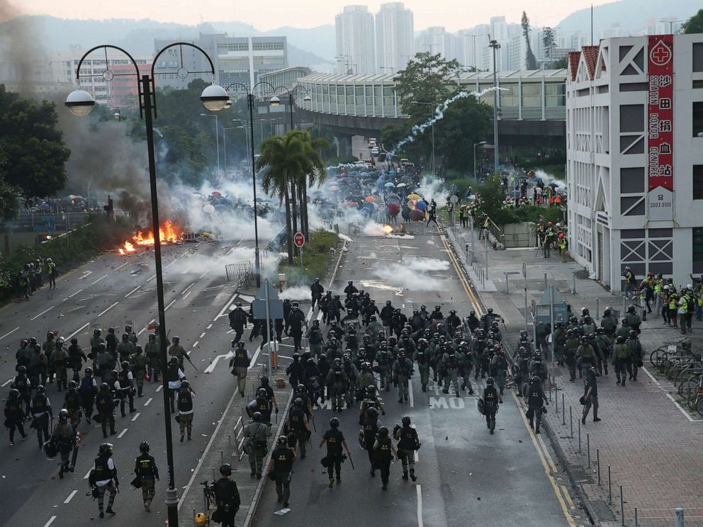 PHOTO: Police try to invade a road occupied by protesters during a protest on National Day in Hong Kong, Oct. 1, 2019.