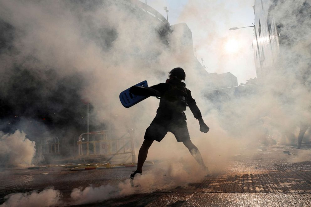 PHOTO:A protester throws an object during a demonstration on Chinas National Day, in Wong Tai Sin, Hong Kong, Oct. 1, 2019.