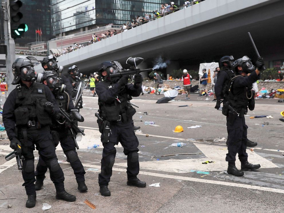 PHOTO: A policeman fires what a crowd control weapon towards protesters near the Legislative Council in Hong Kong, Wednesday, June 12, 2019.