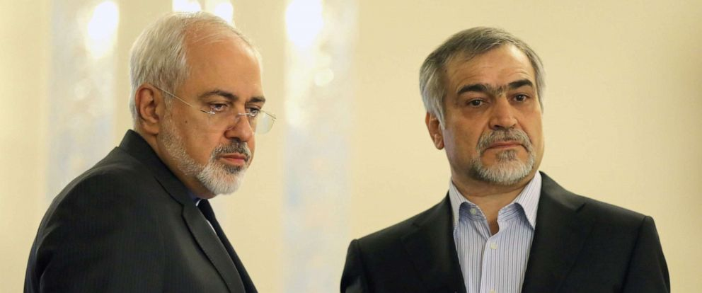 PHOTO: Iranian Foreign Minister Javad Zarif (L) and Hossein Fereydoun, President Rouhanis younger brother and advisor, look on during a press conference of President Hassan Rouhani (unseen) in Tehran on April 3, 2015.