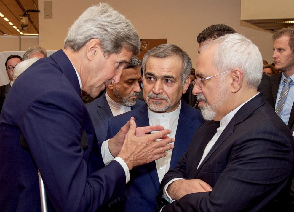 PHOTO: U.S. Secretary of State John Kerry (L) speaks with Hossein Fereydoun (C), the brother of Iranian President Hassan Rouhani, and Iranian Foreign Minister Javad Zarif (R), at the Austria Center in Vienna, Austria, July 14, 2015.
