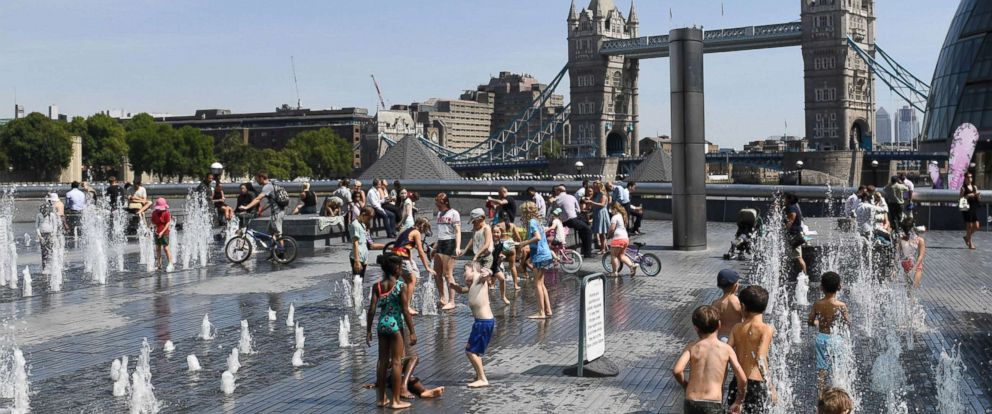 PHOTO: Children cool off in the fountains by the River Thames in London, Aug. 6, 2018.