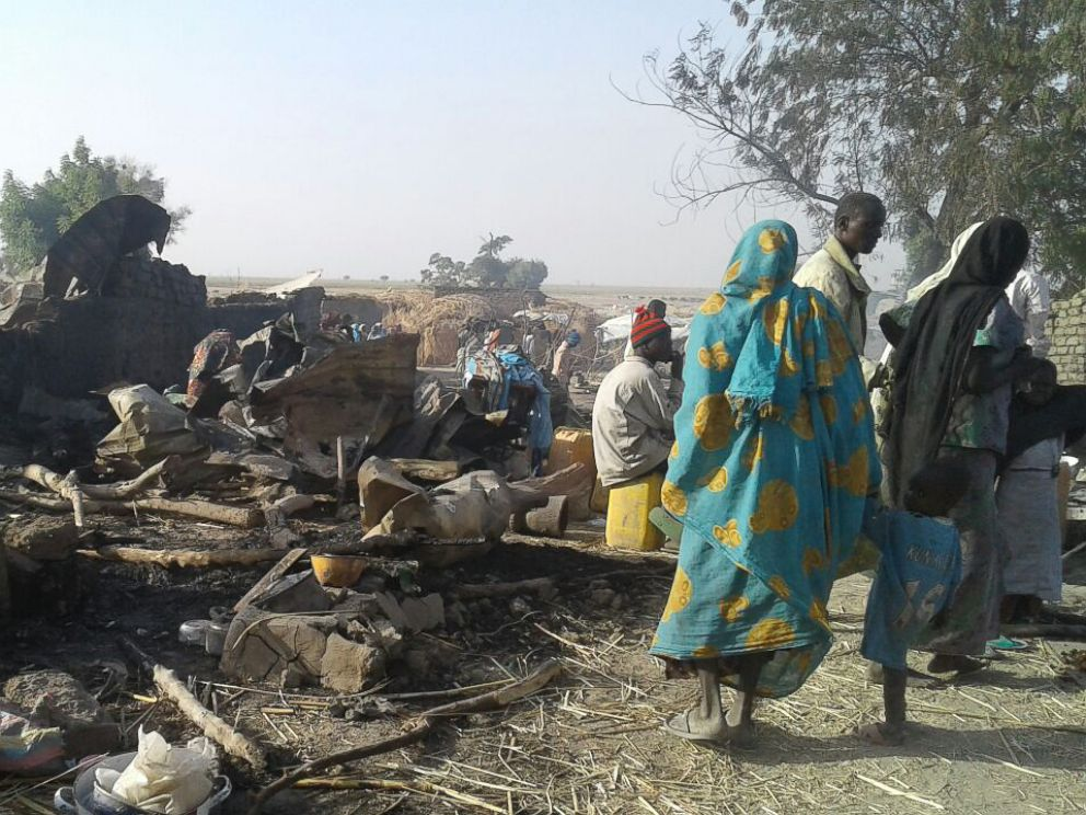 PHOTO: An image released by Doctors Without Borders shows people walking at the site of an accidental military airstrike at an internally displaced persons camp in Rann, Nigeria, Jan. 17, 2017.