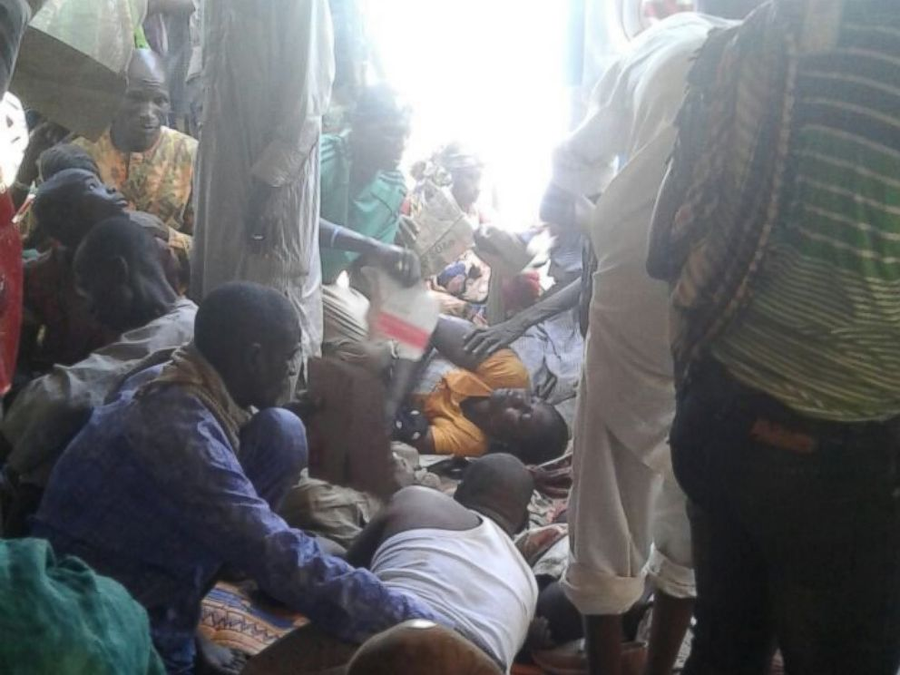 PHOTO: An image released by Doctors Without Borders shows injured people being comforted while waiting for treatment at the site of an accidental military airstrike at an internally displaced persons camp in Rann, Nigeria, Jan. 17, 2017.