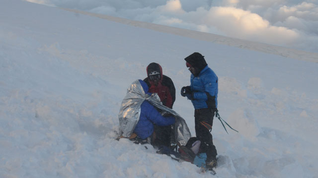 PHOTO:Rescuers put climbers in body heat wraps after at least nine climbers died and nine were injured following an avalanche July 12, 2012 in the French Alps.
