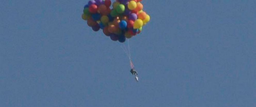 PHOTO: A Man Attached Helium Balloons To A Lawn Chair And Soared Above  Stampede Park