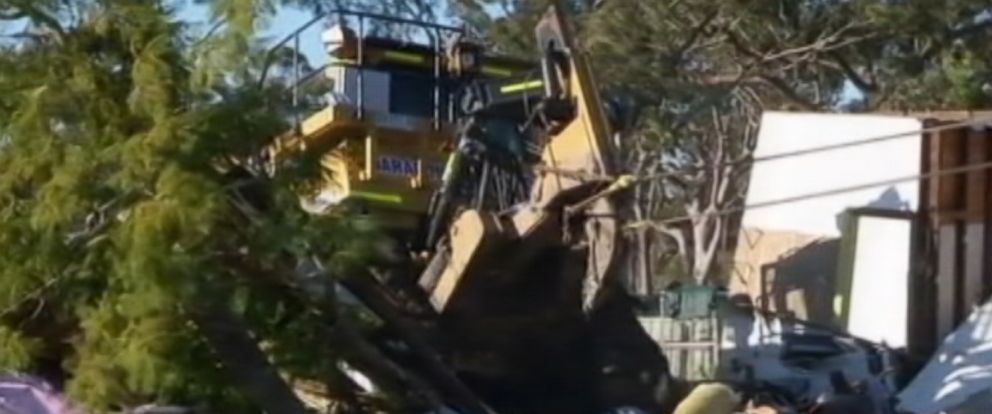 PHOTO: A man who had been ordered to stay away from a family allegedly stole a bulldozer and attacked their home in Teralba, Australia on Monday June 8.