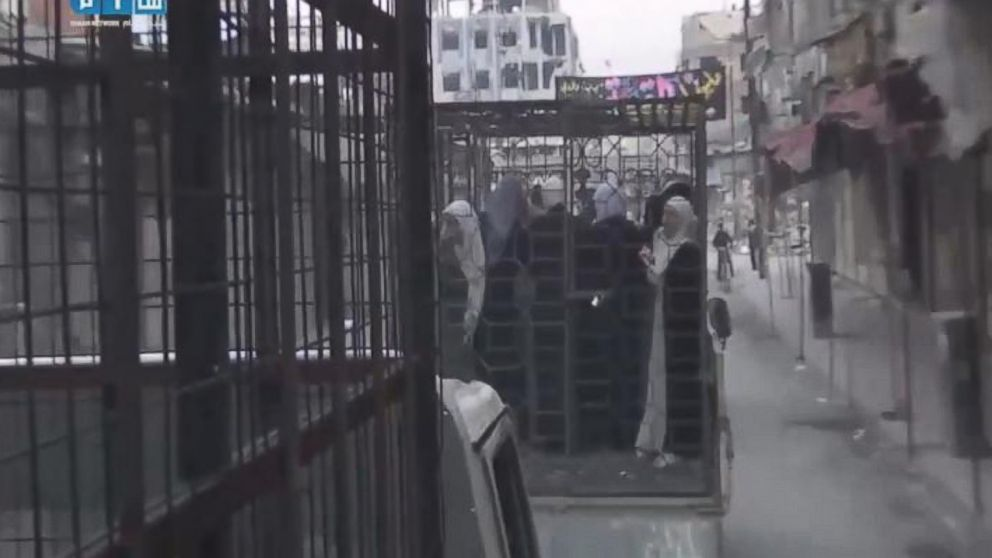 Still image from a video posted on November 1, 2015 showing caged civilians in Eastern Ghouta, Syria.