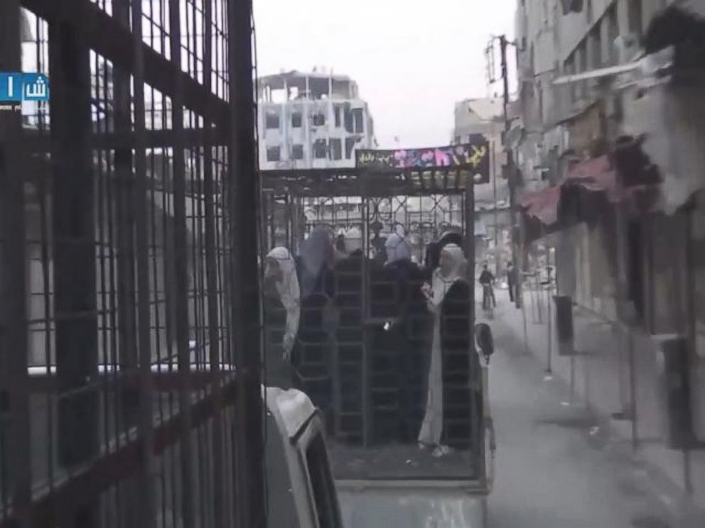 PHOTO: Still image from a video posted on November 1, 2015 showing caged civilians in Eastern Ghouta, Syria.
