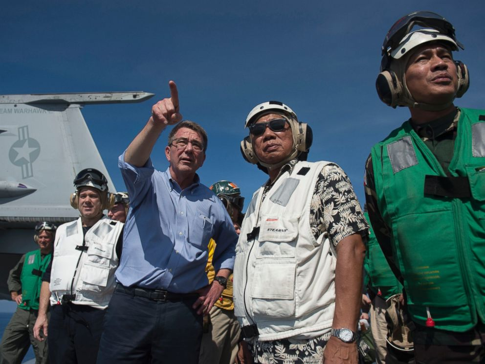 PHOTO: Secretary of Defense and Philippine Secretary of National Defense Voltaire Gazmin (second from right) tour the USS Stennis aircraft carrier as it sails the South China Sea April 15, 2016.