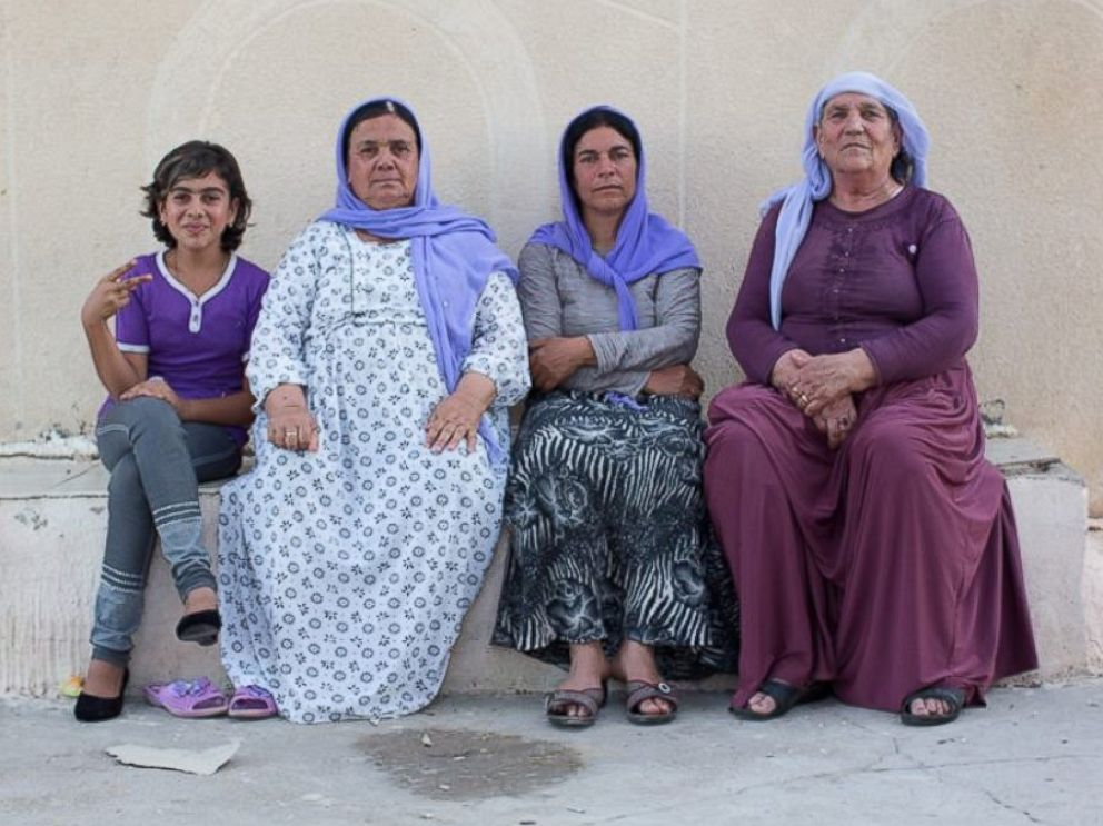 PHOTO: We told her to sit with us so we could share her sadness. Dohuk, Iraq.