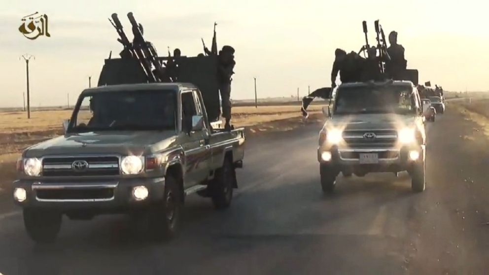ISIS militants race through Raqqa in a propaganda training film released online in September 2014.