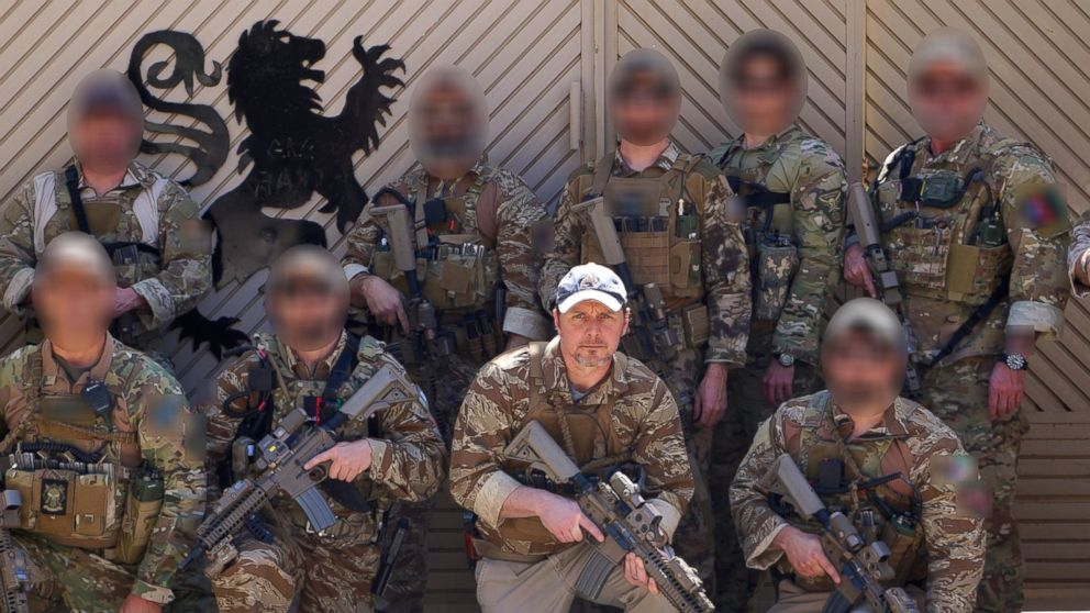 Brett Jones, right of center, poses with CIA GRS troops on a recent deployment.