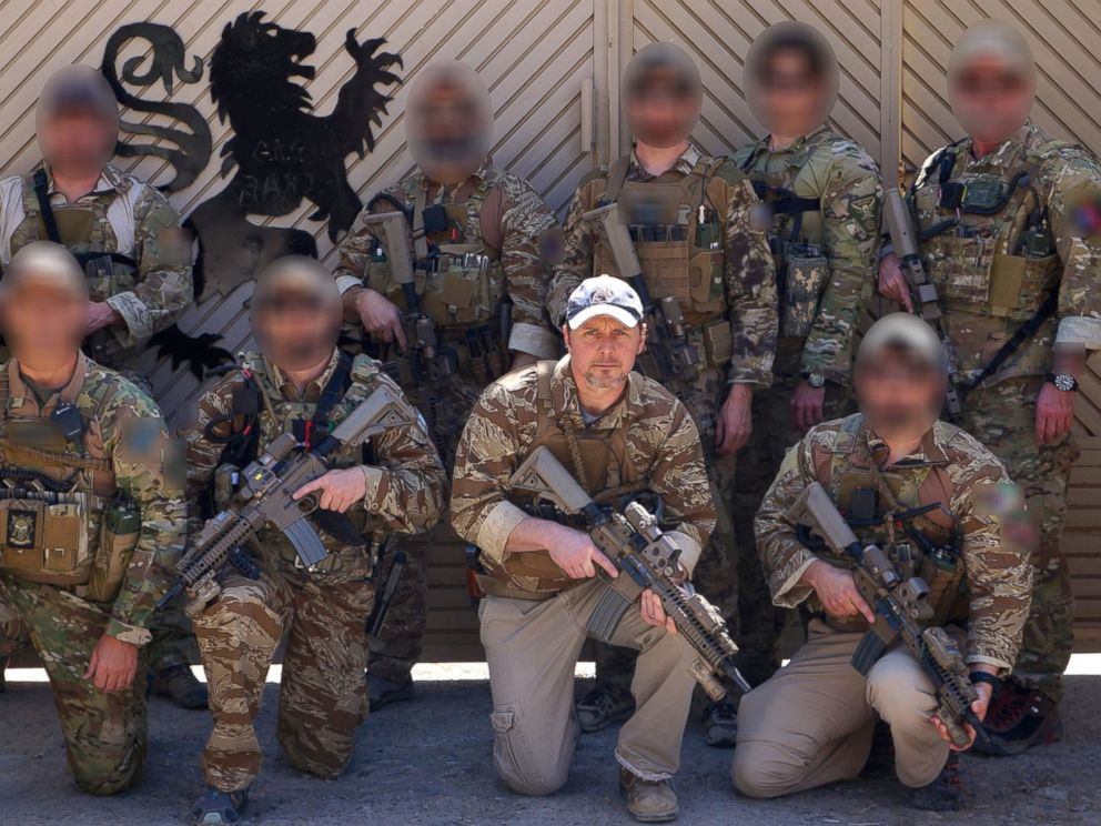 PHOTO: Brett Jones, right of center, poses with CIA GRS troops on a recent deployment.