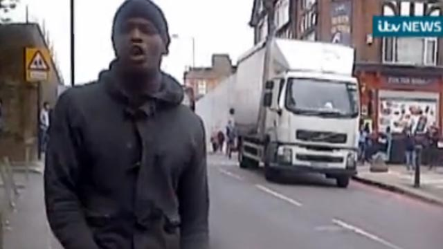 PHOTO: A man that attacked a British soldier in broad daylight reacts to the stabbing in a bystander video obtained by ITV, May 21, 2013.