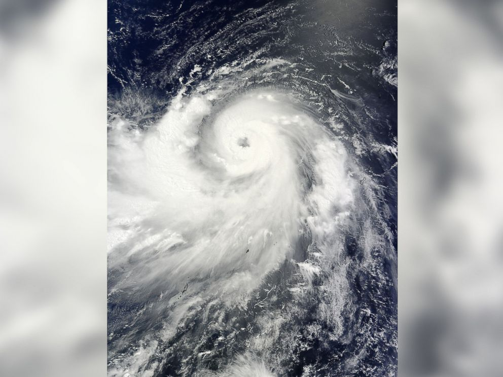 PHOTO: The MODIS instrument aboard NASAs Terra satellite captured this visible image of Typhoon Neoguri on the evening of July 4, 2014 as it moved through the Northwestern Pacific Ocean.