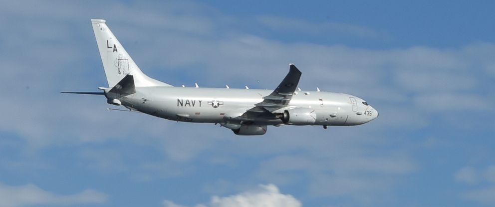 PHOTO: A P-8A Poseidon from Patrol Squadron Five flies during a routine exercise in the Philippine Sea, Sept. 26, 2014.
