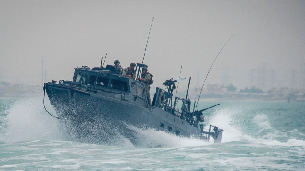 A riverine command boat transits through rough seas during patrol operations in the Arabian Gulf, Oct. 30, 2015.