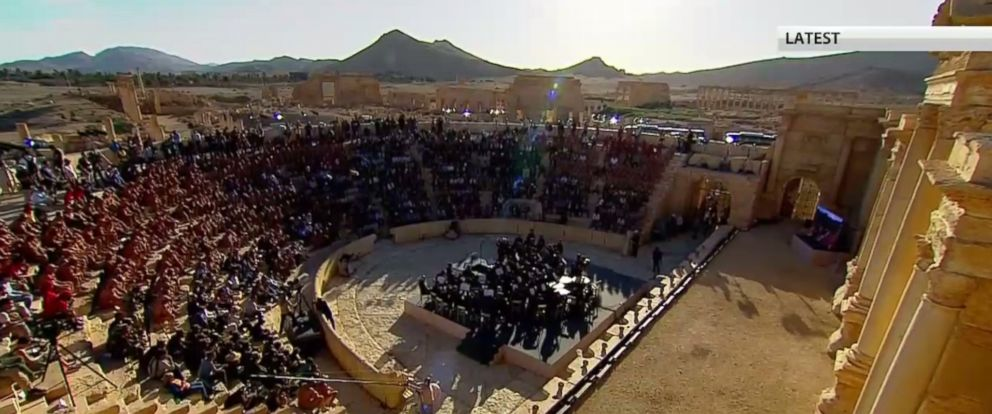 PHOTO: Russias Mariinsky Theatre Orchestra performs in a Roman amphitheater in Palmyra in a still made from video from Russian television.