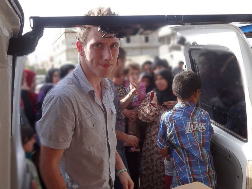 PHOTO: Peter Kassig delivering aid in Lebanons Bekaa Valley in May 2013.