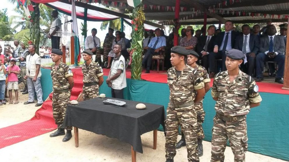 Soldiers guard the silver bar found off the coast of Madagascar.