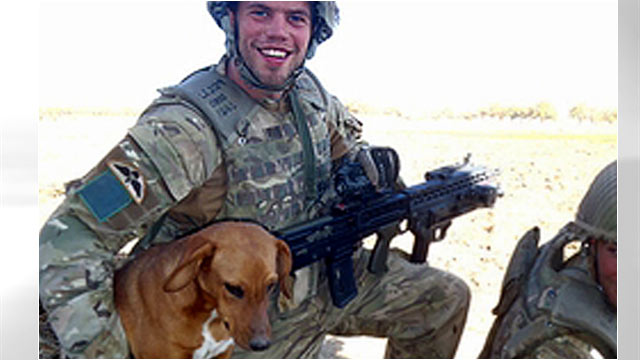 PHOTO: Pte. Conrad Lewis from the 4th Battalion, Parachute Regiment, is shown with his dog, Pegasus.