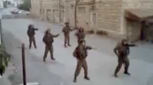 PHOTO The Israeli army is investigating a video posted on Youtube featuring a male soldier performing a belly dancing routine besides a blindfolded female Palestinian prisoner.
