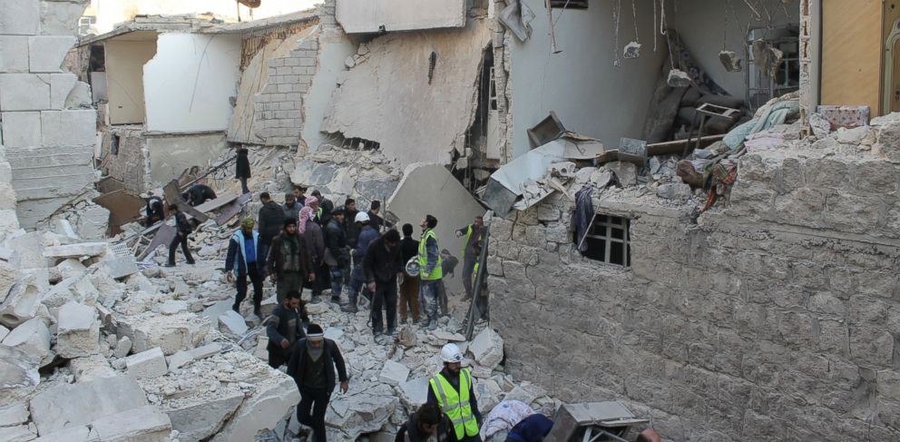 PHOTO: Civil Defense and residents look for people trapped under the rubble after an air raid on the As-Sukkari neighborhood in Aleppo, Syria.