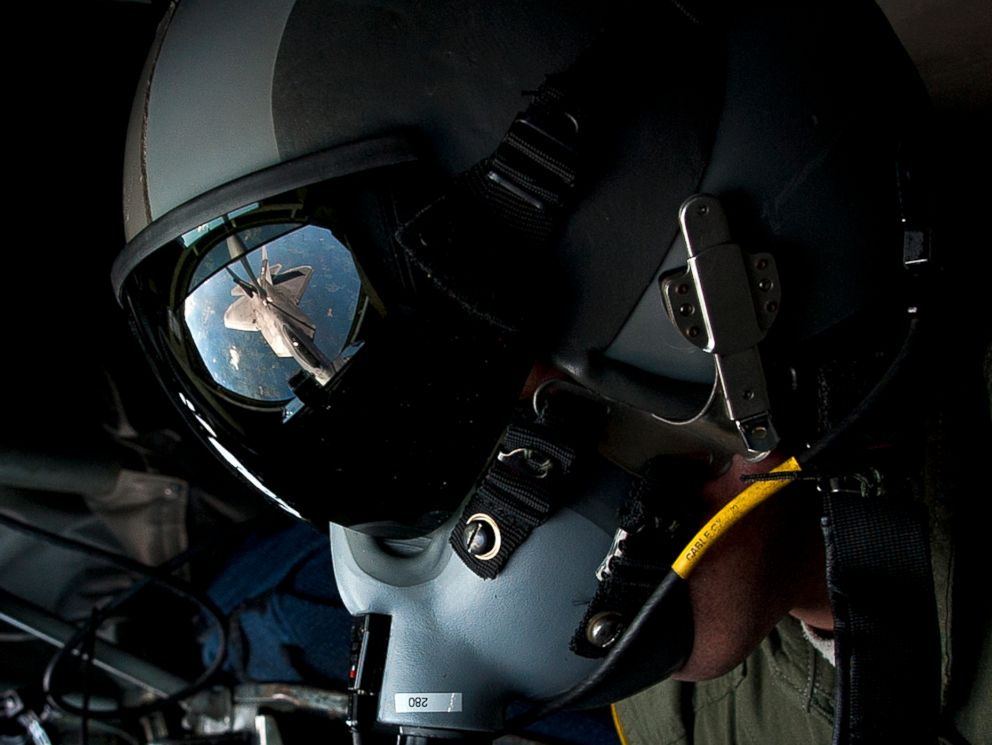 PHOTO: U.S. Air Force Tech. Sgt. Bartek Bachleda, a KC-135 Stratotanker boom operator instructor with the 54th Air Refueling Squadron at Altus Air Force Base, Okla., refuels an F-22 Raptor aircraft, Aug. 21, 2012, over New York.