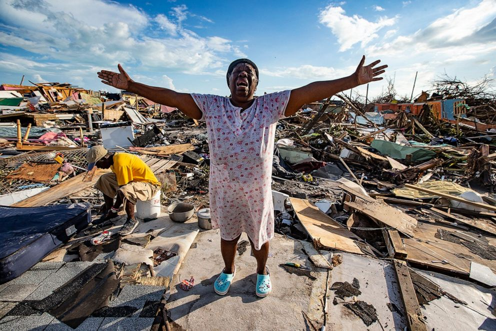 PHOTO: Aliana Alexis, of Haiti, stands on the concrete slab of what is left of her home after destruction from Hurricane Dorian in an area called The Mud at Marsh Harbour in Great Abaco Island, Bahamas, Sept. 5, 2019.