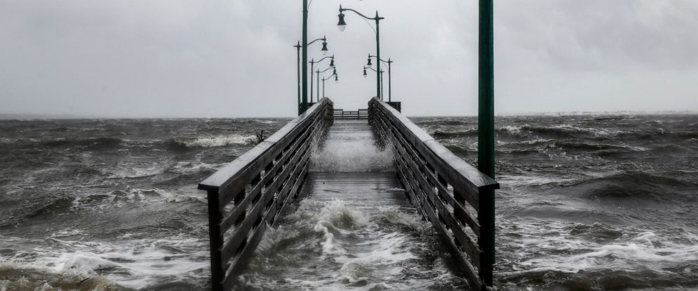 PHOTO: Strong gusts of wind and bands of heavy rain cover a walkway at the Jensen Beach Causeway Park in Jensen Beach, Florida, Sept. 3, 2019.
