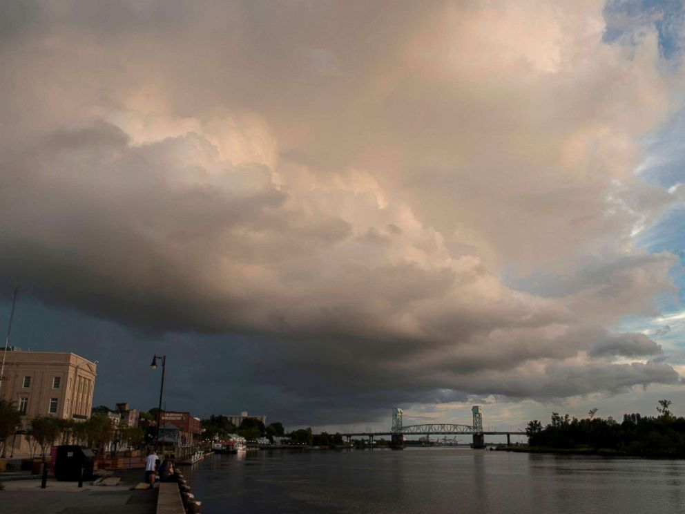 PHOTO: A large rain cloud passes over a day before the arrival of hurricane Florence in Wilmington, N.C. on Sept. 12, 2018.