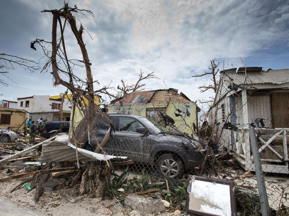 PHOTO: This handout photograph provided courtesy of the Dutch Department of Defense on Sept. 7, 2017, shows houses and cars damaged after the passage of Hurricane Irma on the Dutch Caribbean island of St. Maarten.