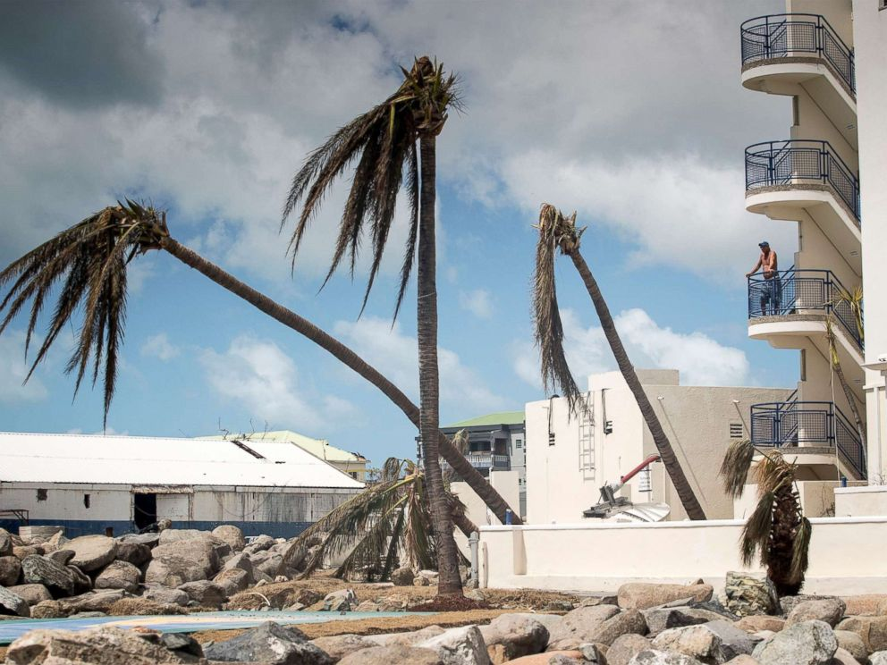 PHOTO: This handout photograph provided courtesy of the Dutch Department of Defense on Sept. 8, 2017, shows a man looking on over the devastation of Hurricane Irma on the Dutch Caribbean island of St. Martin.