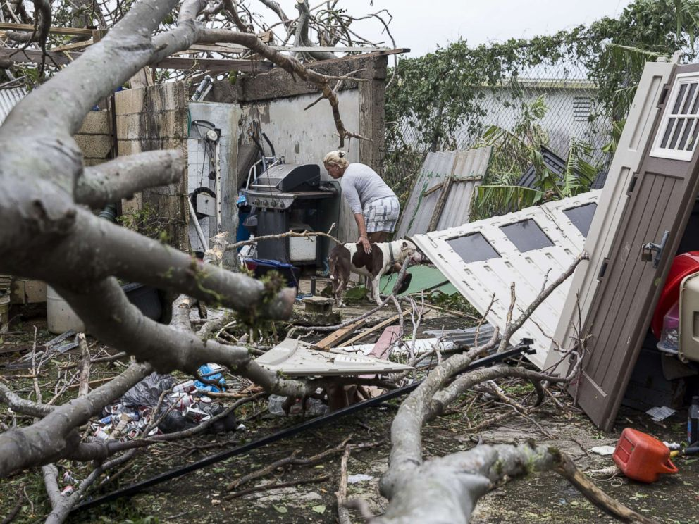 PHOTO: A resident surveys the damage to her property after Hurricane Maria made landfall, Sept. 21, 2017, in the Guaynabo suburb of San Juan, Puerto Rico.