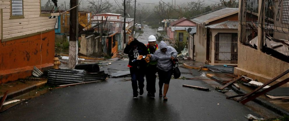 PHOTO: Rescue workers help people after the area was hit by Hurricane Maria in Guayama, Puerto Rico, Sept. 20, 2017.