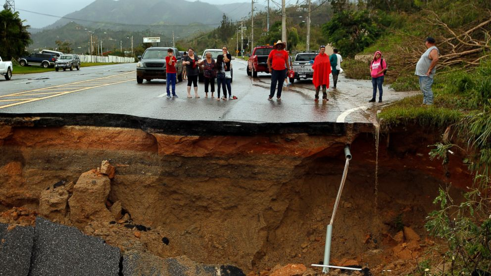 Highway 10, a major north-south connection through Puerto Rico is completely washed out, leaving people cut off, Sept. 23, 2017. In the mountain town of Utuado, Puerto Rico, residents are struggling to recover after hurricane Maria. The main north-south road has completely washed out in one section, leaving people on the on the south side cut off.