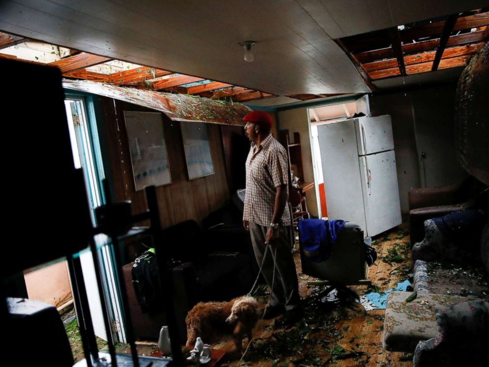 PHOTO: Agapito Lopez looks at the damage in his house after the area was hit by Hurricane Maria in Guayama, Puerto Rico, Sept. 20, 2017.